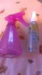 Pink Spray bottle is water and conditoner.